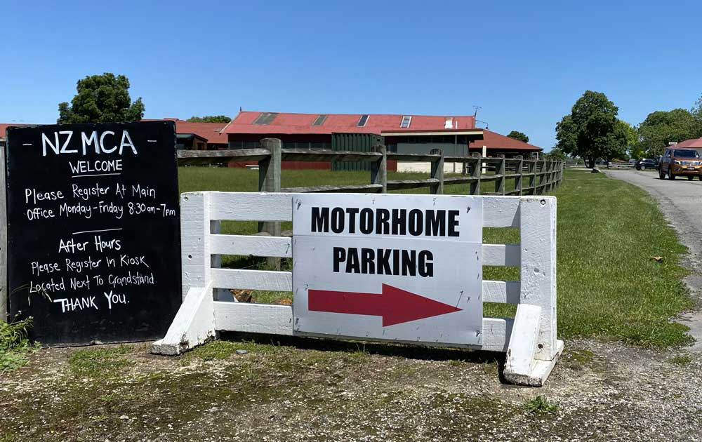 Image of the entrance and motorhome parking sign